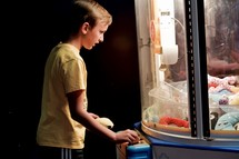 a boy playing in an arcade
