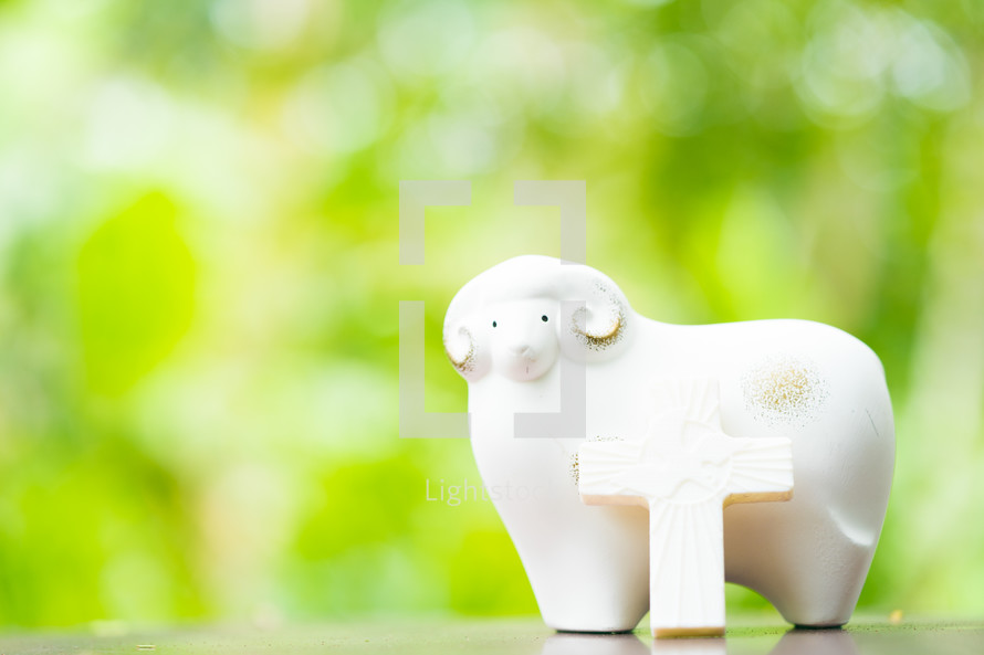 sheep and cross figurine