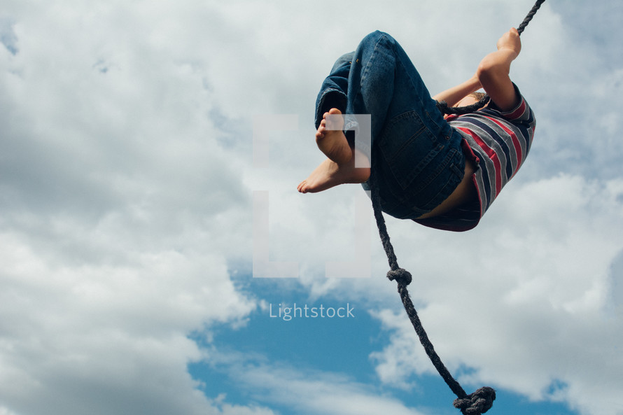 a child swinging on a rope