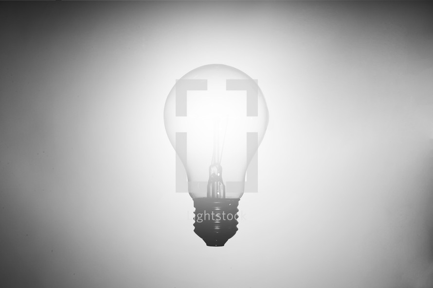 glowing lightbulb on white background