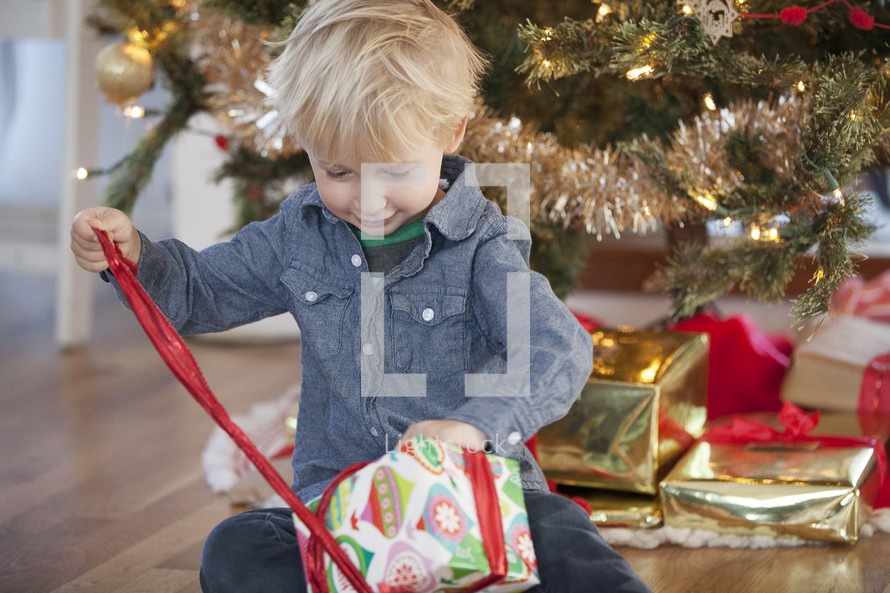 A child opening a Christmas present.