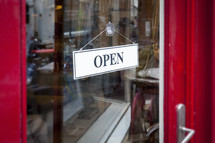 open sign on a store door