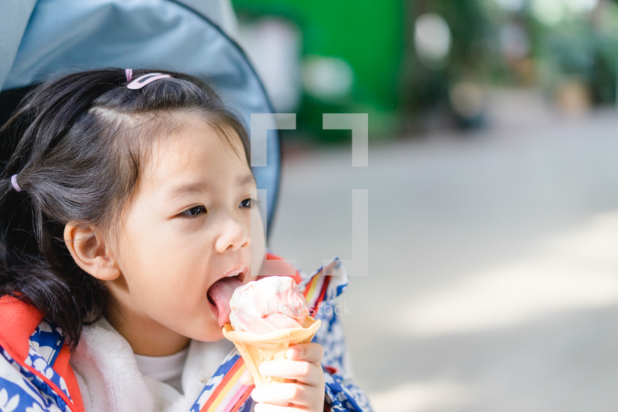 kid eating an ice cream cone