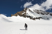 a man hiking up a snowy mountain