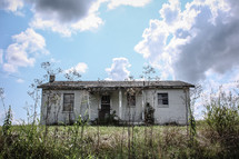 Dilapidated house in a field.