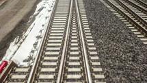 snow along train tracks