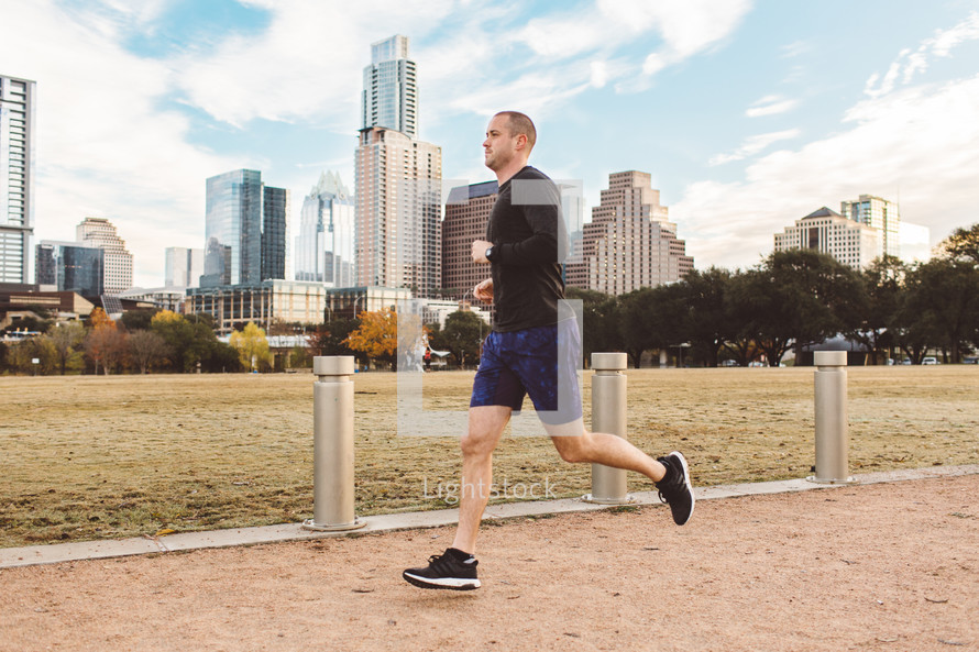 a man running in a city park