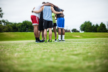 team prayer on a sports field