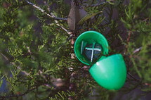 plastic Easter egg filled with a cross