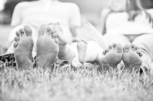feet of mother, father, and baby