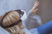woman using VR glasses
