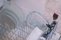 clean dishes in the dishwasher
