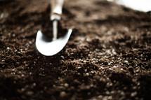 shovel on potting soil