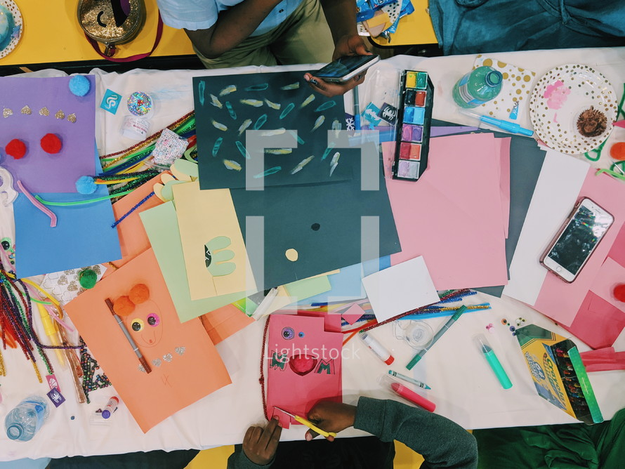 children coloring and cutting paper
