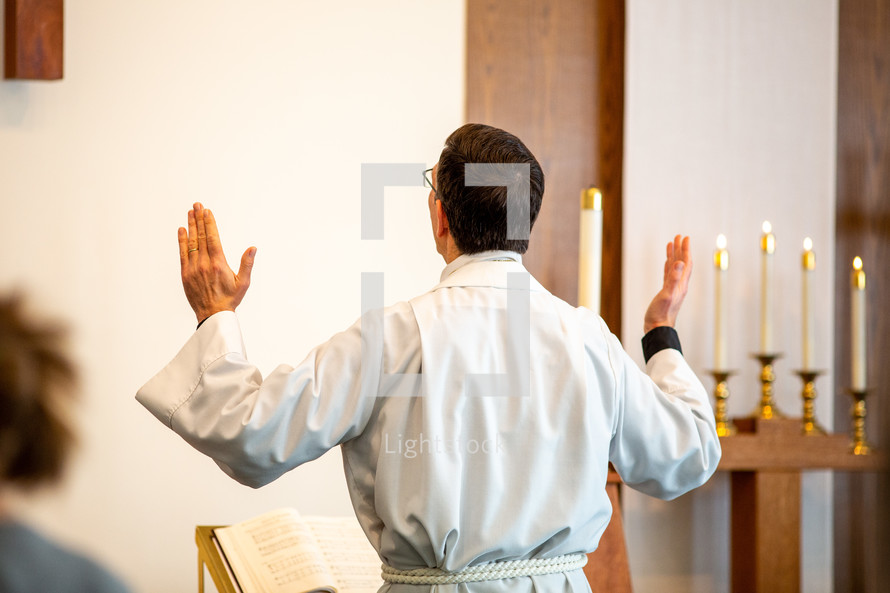 pastor with hands raised