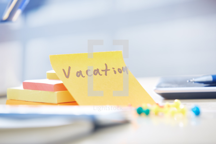 vacation note on a desk