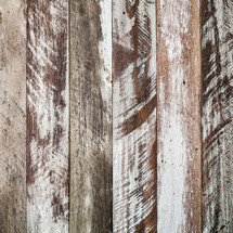 scratched and weathered wood boards background