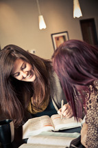 Woman smiling at a Bible study.