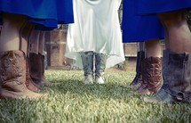 bride and bridesmaid in cowboy boots