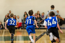 Boys on a basketball court.