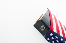 Spanish Holy Bible wrapped in an American flag.