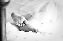 infant girls bare feet