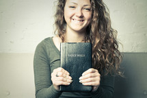 teen girl holding a Bible
