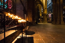 prayer candles burning in cathedral.