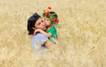 Happy family on a summer meadow.
