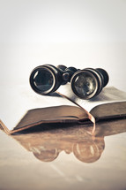 binoculars on a Bible