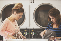 women in conversation at a laundromat