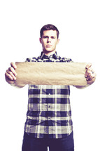 man holding a blank paper scroll