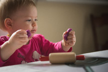 toddler girl playing with play-dough
