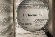 magnifying glass over Bible - 1 Chronicles