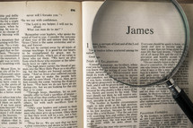 magnifying glass over Bible - James