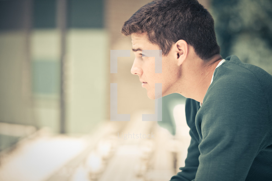 side profile of a young teenage kid