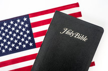 Holy Bible on an American flag.