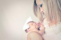 mother cradling her newborn daughter