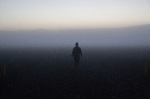 woman standing in fog in Iceland