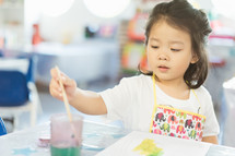 child in an apron painting