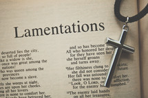 Lamentations and a cross necklace