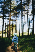 a kid walking through a forest