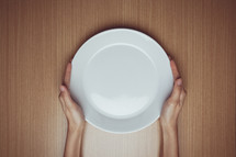 hand on an empty plate