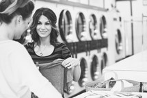 women doing laundry in a laundromat