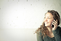 Smiling girl using smart phone.