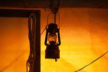 a lantern handing on a hook