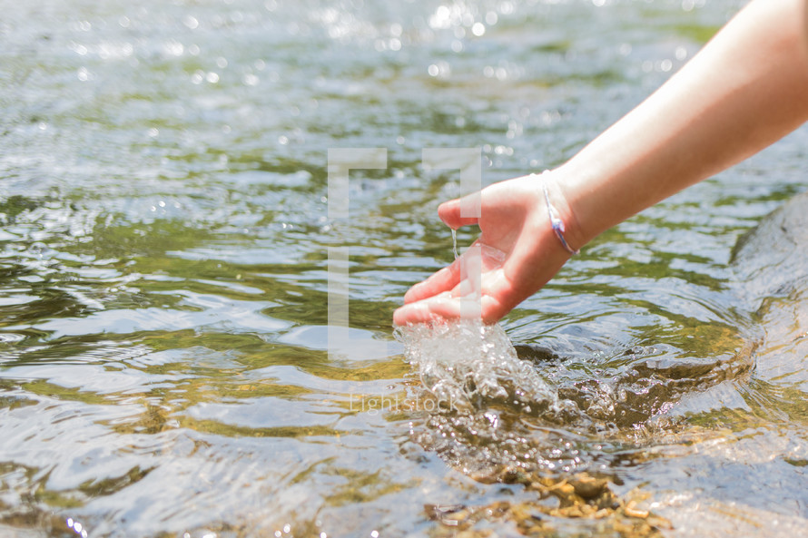 a hand touching water