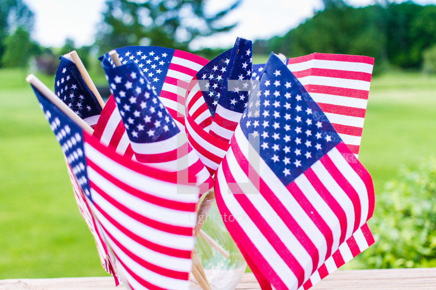 American flags in a vase