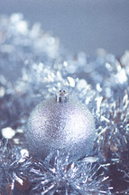 Close-up of silver christmas orb decoration.