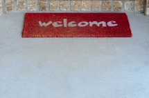 Welcome mat at the front door.